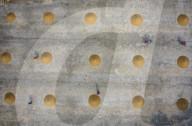 FEATURE -  Perfekte kreisförmige Haufen aus getrocknetem Reis in Bangladesch