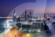 FEATURE -  Märchenhaft: Immobilienfotograf Zohaib Anjum zeigt die moderne Architektur von Dubai im morgendlichen Nebel